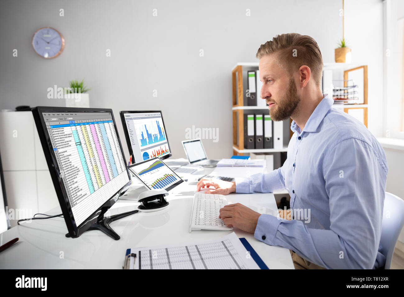 Businessperson Calculating E-Invoice Online On Computer At Office - Stock Image