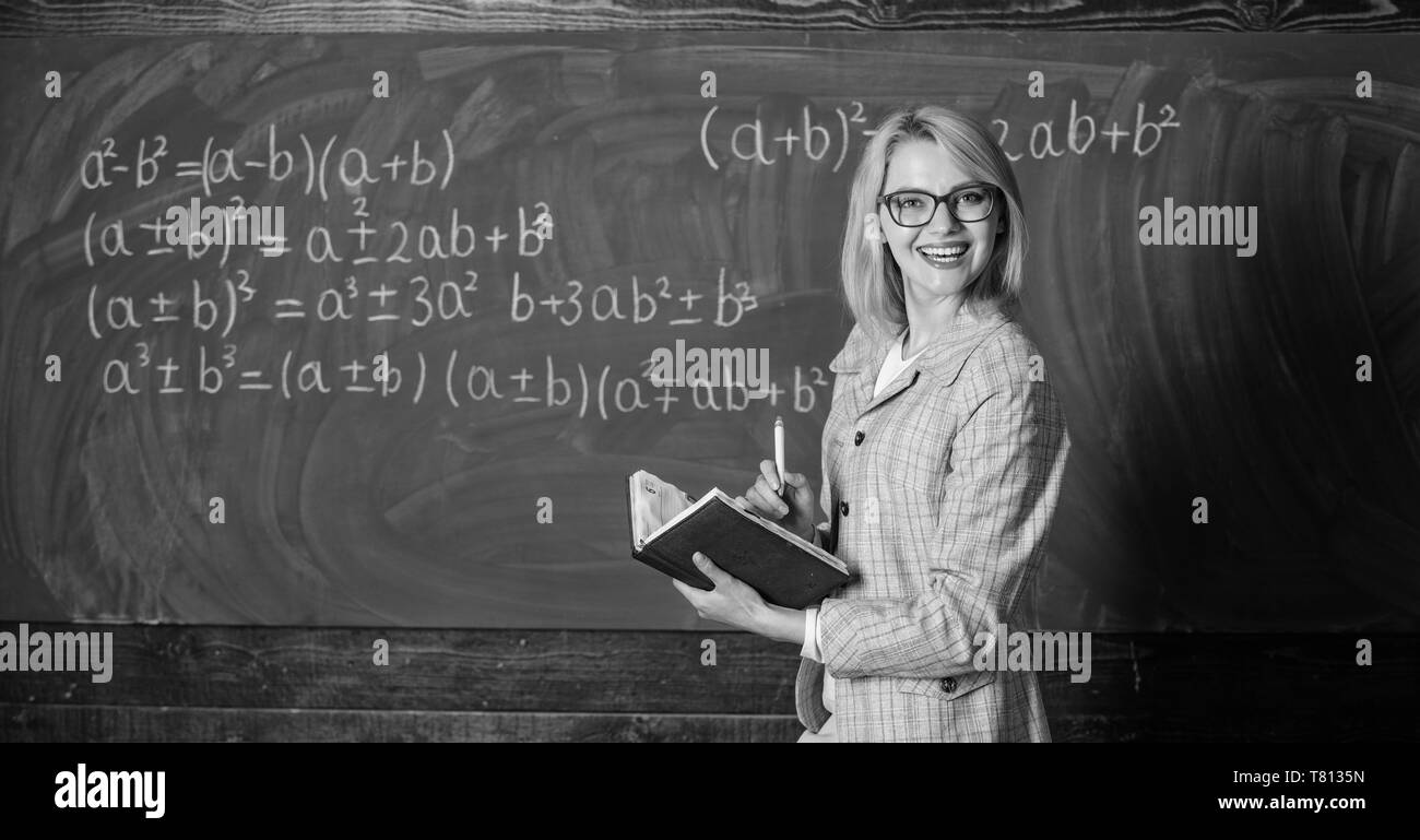 Effective teaching involve acquiring relevant knowledge. Woman teaching near chalkboard in classroom. Qualities that make good teacher. Effective teaching involve prioritizing knowledge and skills. - Stock Image
