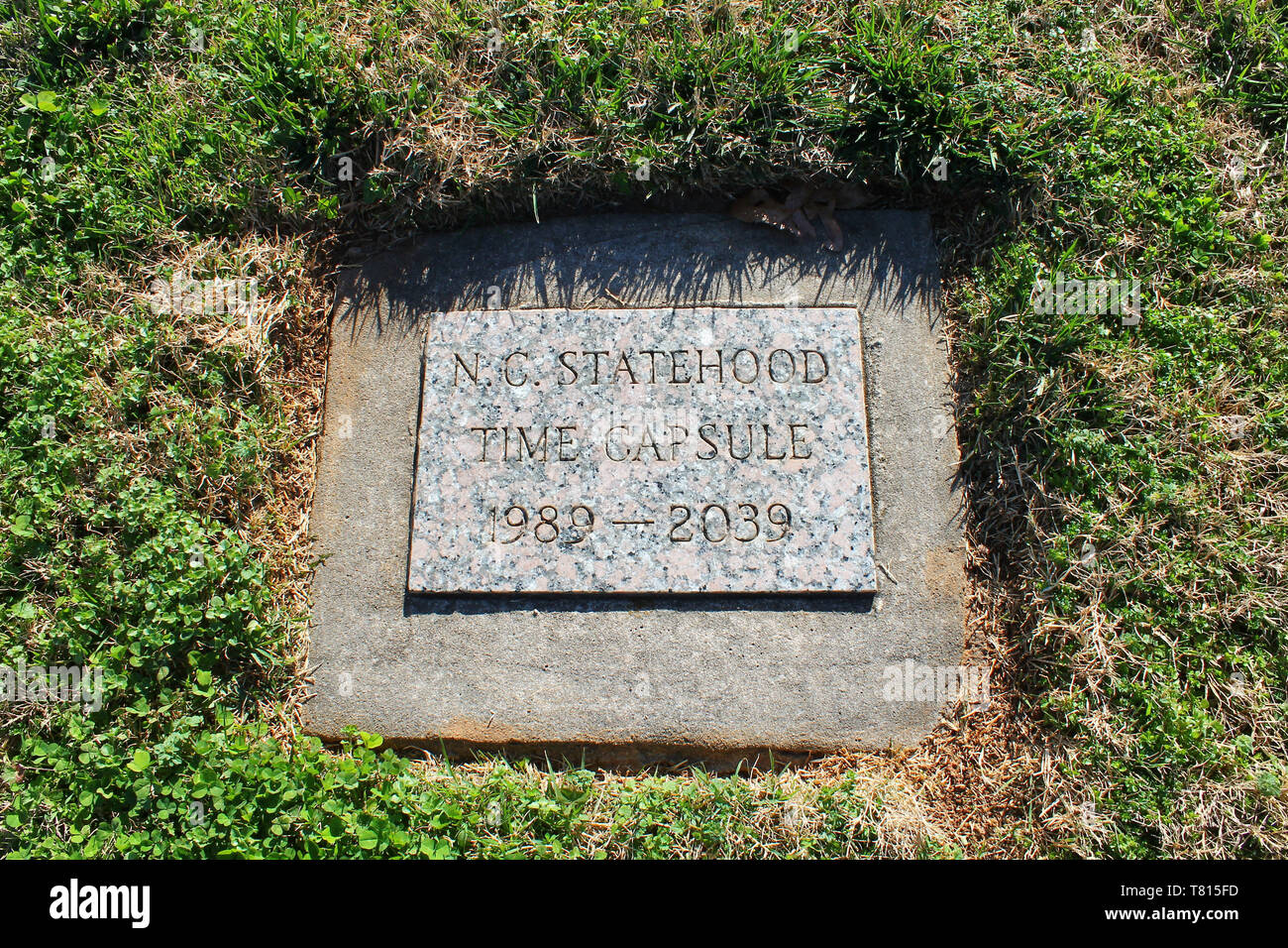 A time capsule is marked so a future generation will unearth it in 50 years. Stock Photo