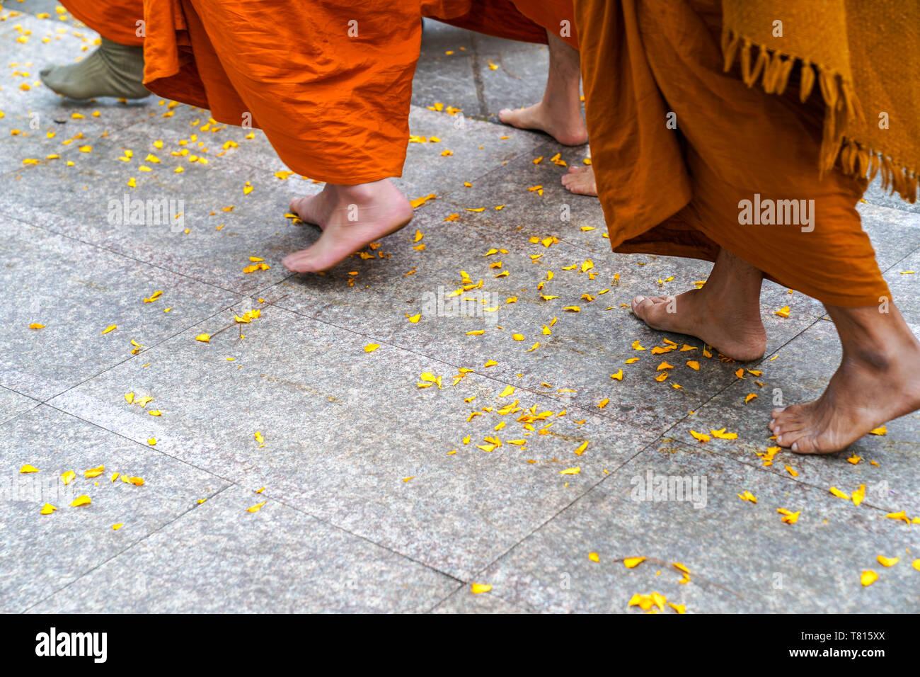Step Of Monks Feet Walk On Terrazzo Floor With Yellow