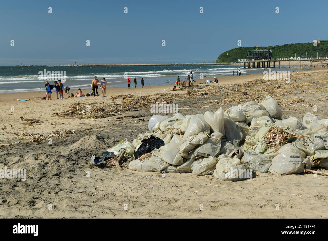 Durban, South Africa, collection of plastic bags lying in heap, beach cleaning in progress after April, 2019, storm damage, people, landscape, city - Stock Image