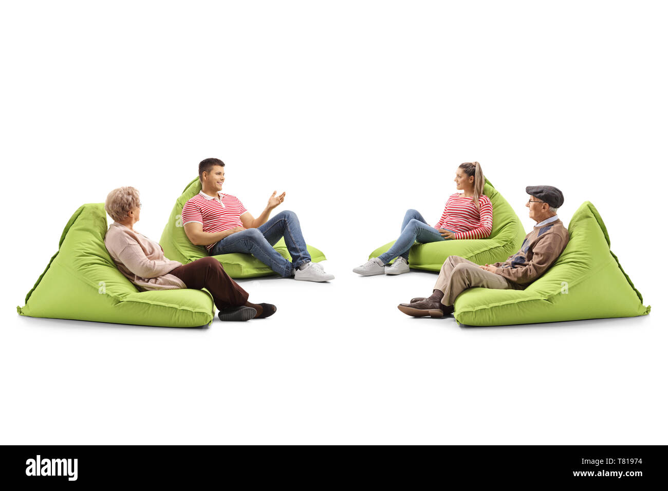 Young and senior people sitting on bean bag chairs and talking isolated on white background - Stock Image