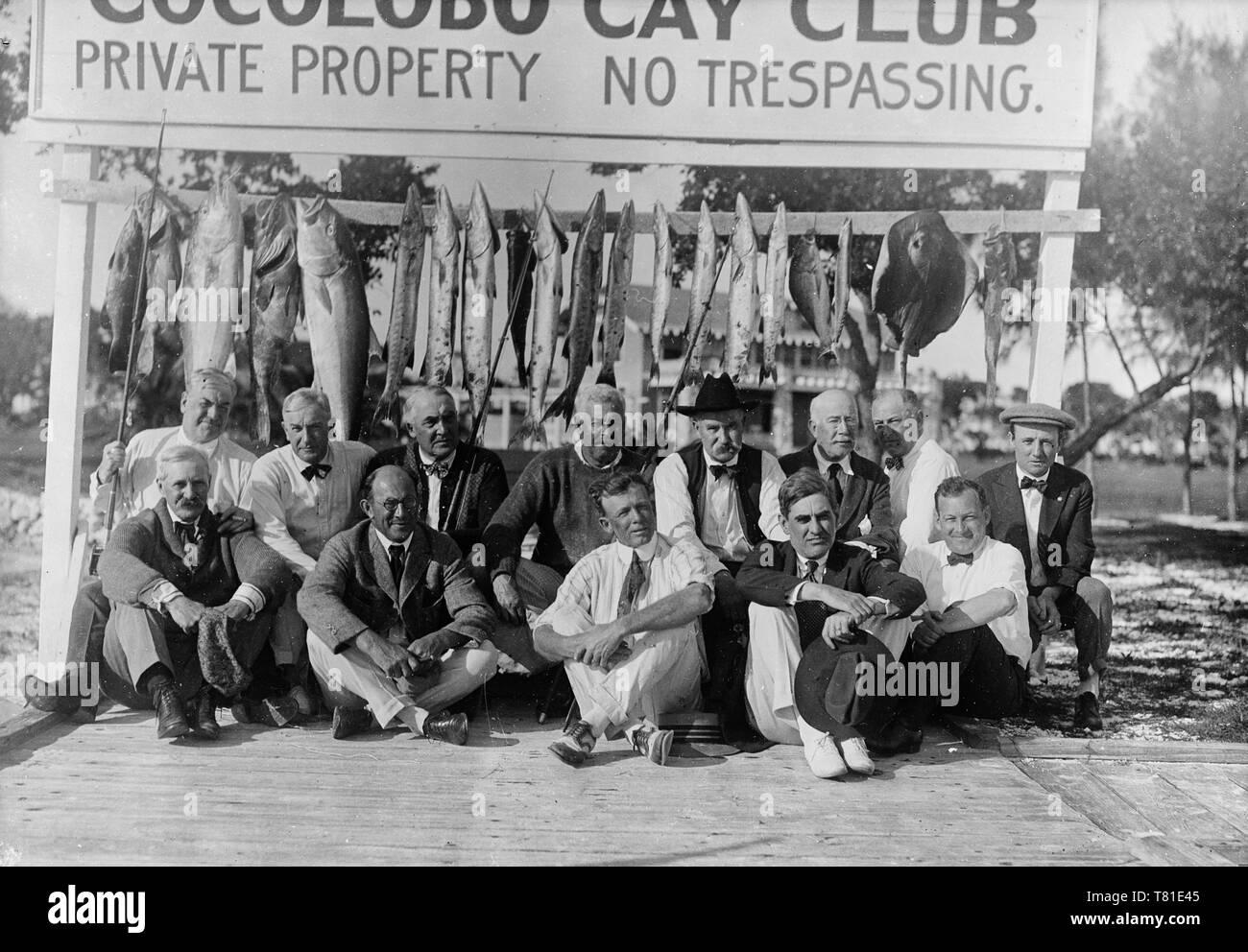 Warren Harding and group with fish at Cocolobo Cay Club, Adams Key, Florida, circa 1921 - Stock Image