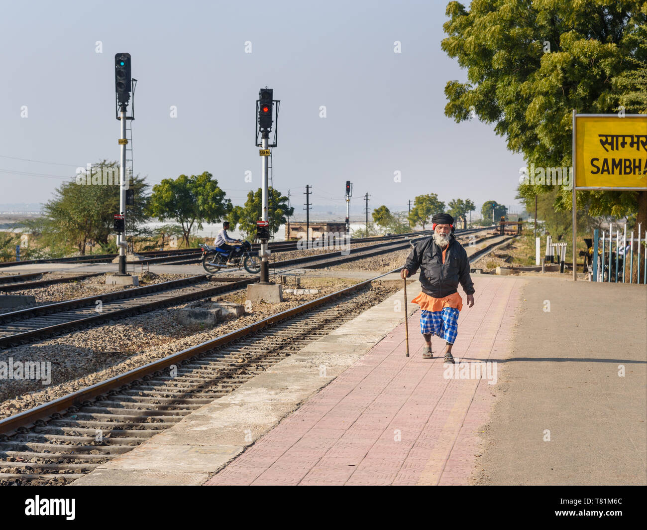 Sambhar, India - February 02, 2019: Elderly Indian man walks along the train platform at the station - Stock Image