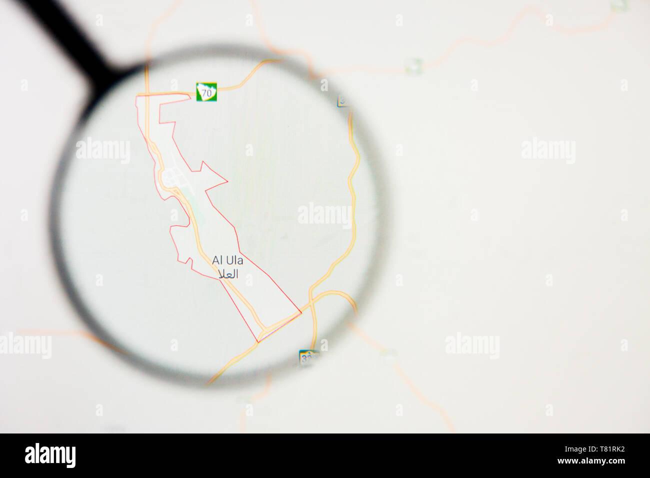 Al-Ula city in Saudi Arabia visualization illustrative concept on screen through magnifying glass - Stock Image