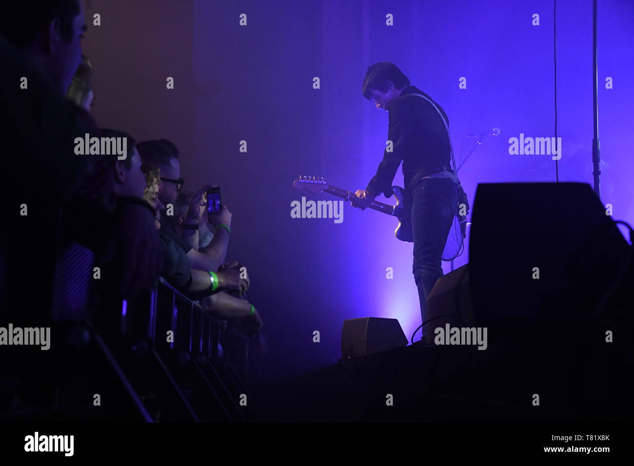 Singer, songwriter and guitarist Johnny Marr is shown performing on stage during a live concert appearance. - Stock Image