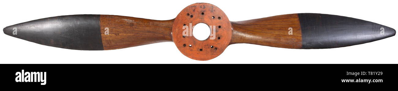 An exceptionally rare, presumably German two-blade laminated walnut propeller Circa 1927, the boss stamped DP and stencilled 724 on the reverse face, originally drilled for a ten stud propeller-shaft-mounting then redrilled for an alternative propeller shaft, the boss streamlined so as to mate with a propeller cone. signs of usage and wear, the broad blades with deep chord, finished in black to approximately half length of each blade, the boss 44 cm diameter, the propeller 310 cm diameter. Provenance: Maxwell-Hunt propeller collection. historic, historical, troop, troops, a, Editorial-Use-Only Stock Photo