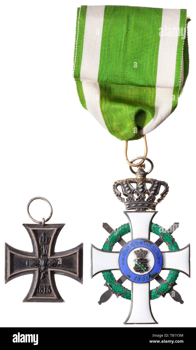 """A Commander's Cross to the Order of Albert with Swords bestowed in 1915 to Prussian Oberst (Colonel) Wilhelm Rotte, staff officer of the engineer and pioneer corps of fortress Posen and later general of pioneers. The Cross of the Order in gilt silver issue (""""S"""" in lower cross arm) of the Scharffenberg firm in Dresden with corresponding designation in the lateral cross arms. On an especially long, original neck ribbon. Numerous small defects in the blue enamel of the medallion, otherwise very beautiful. Included is the general's Iron Cross 2nd Cla, Additional-Rights-Clearance-Info-Not-Available Stock Photo"""