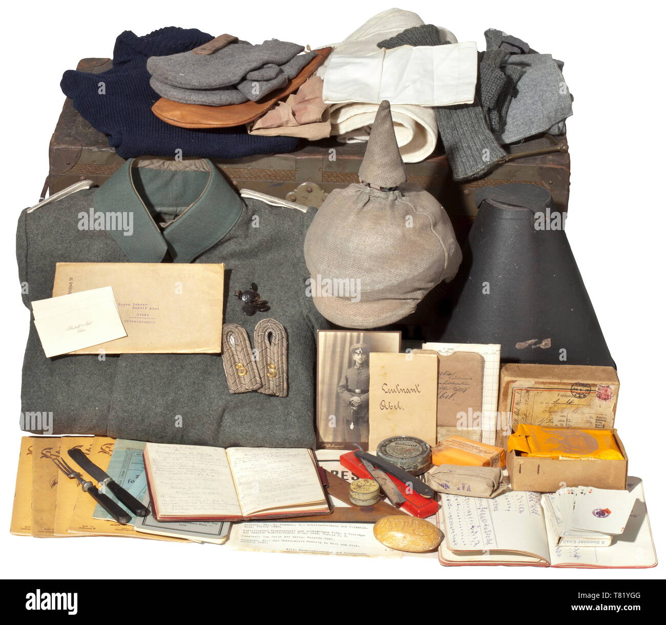 The large estate of uniforms and documents from the possessions of Reserve Lieutenant Rudolf Abel from Stade. A Prussian field tunic M 1915 for an infantry lieutenant, made of field-grey cloth, dark green collar, covered button flap, sewn-on shoulder boards, and green lining. The tunic in perfect, unissued condition. A spiked helmet M 1915 for infantry officers, from circa 1918. Th 20th century, Additional-Rights-Clearance-Info-Not-Available - Stock Image