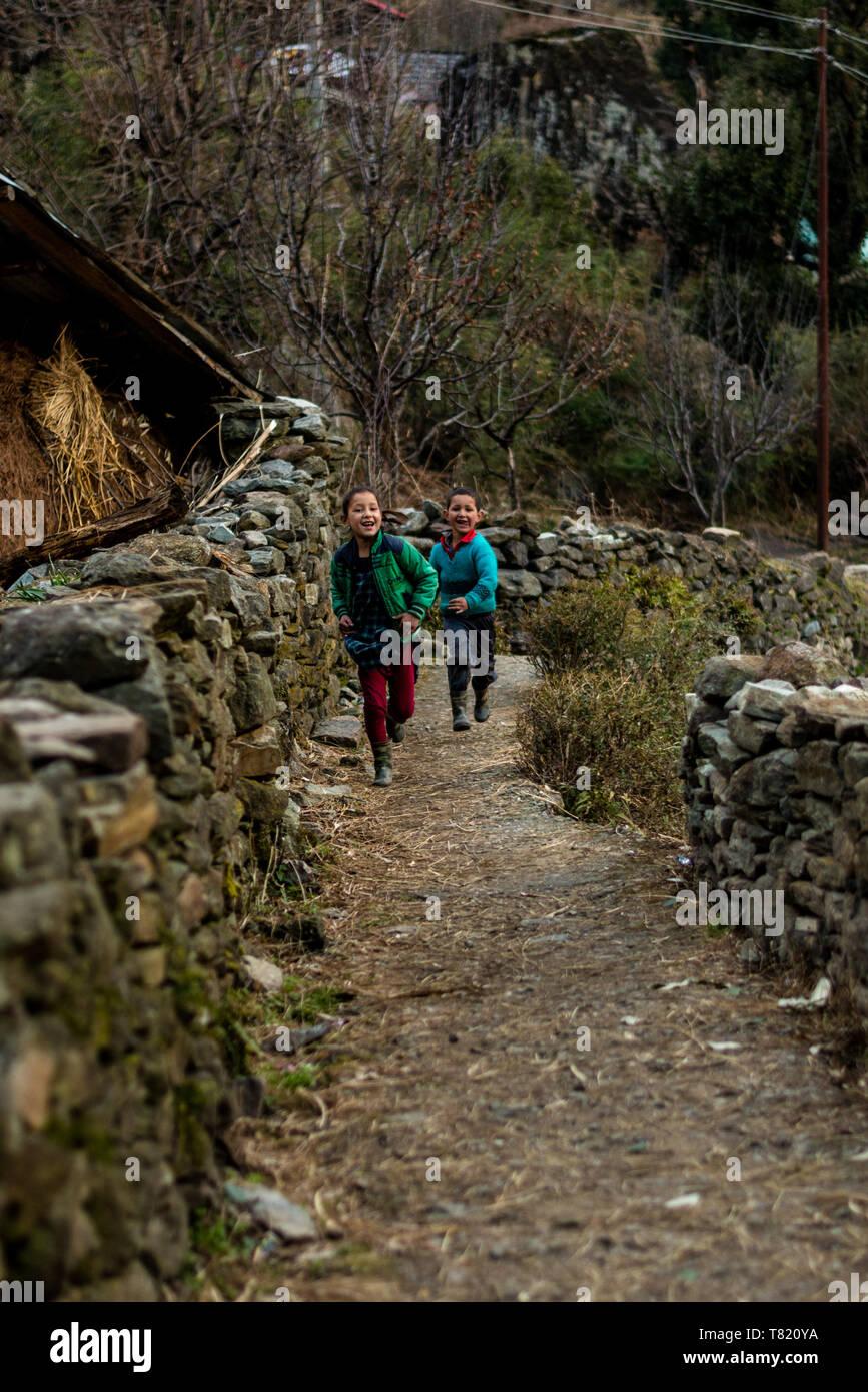 Kullu, Himachal Pradesh, India - February 04, 2019 : Photo of himalayan kid running in Himalayas - - Stock Image