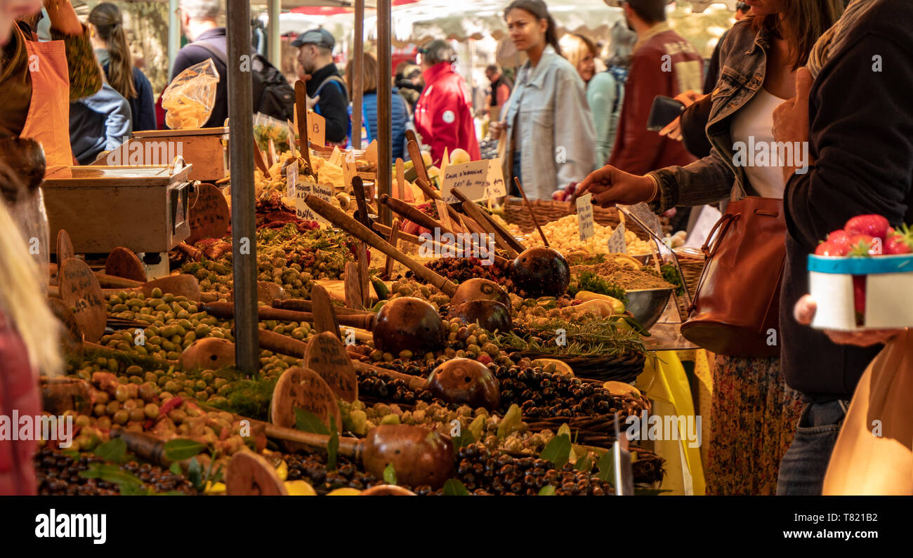 Fresh produce on display at a local farmers market in the town of Uzes in the south of france. We see local produce of olives, fruits, nuts vegetables Stock Photo