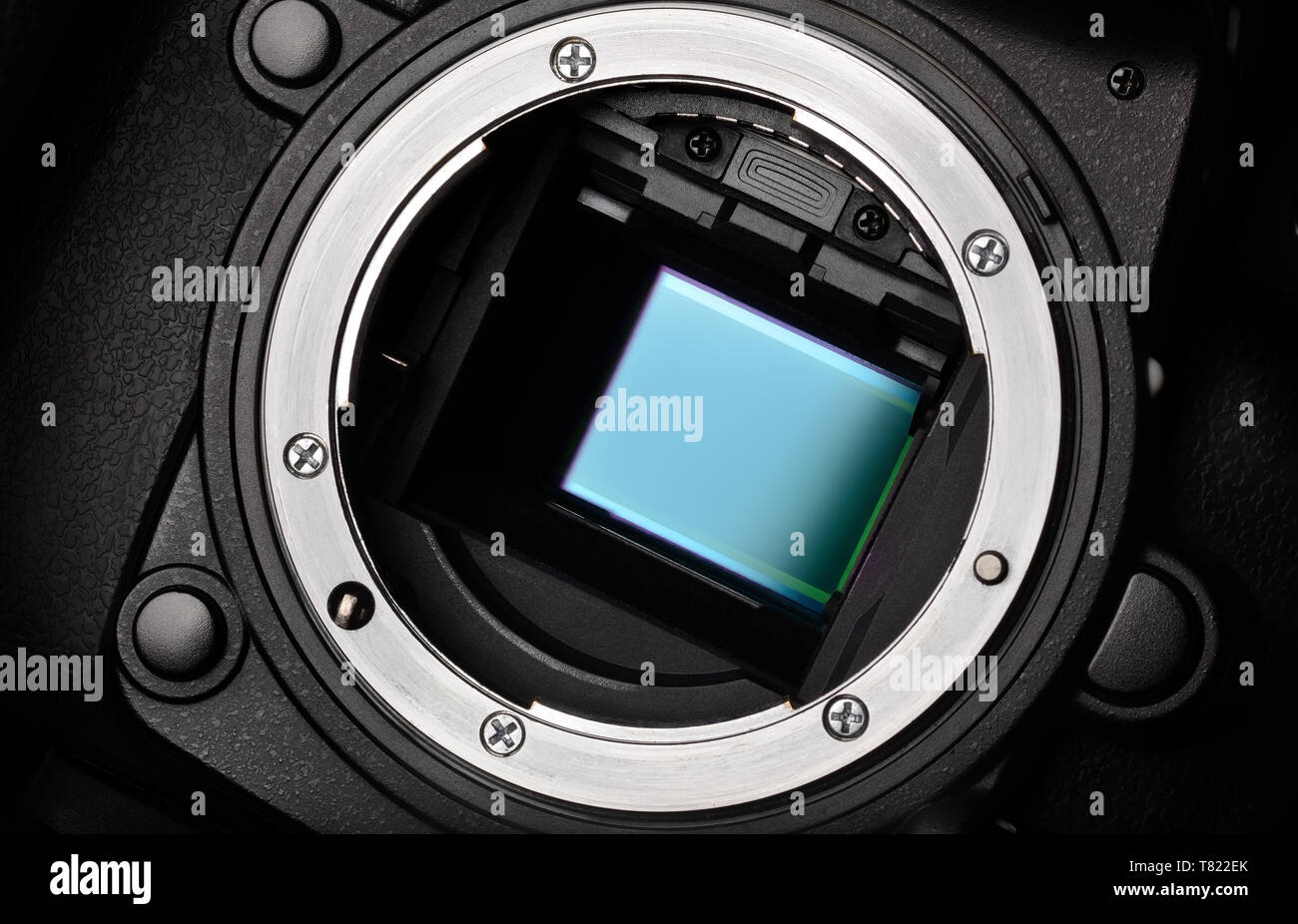 Digital camera APS-C sensor and lens mount close-up - Stock Image
