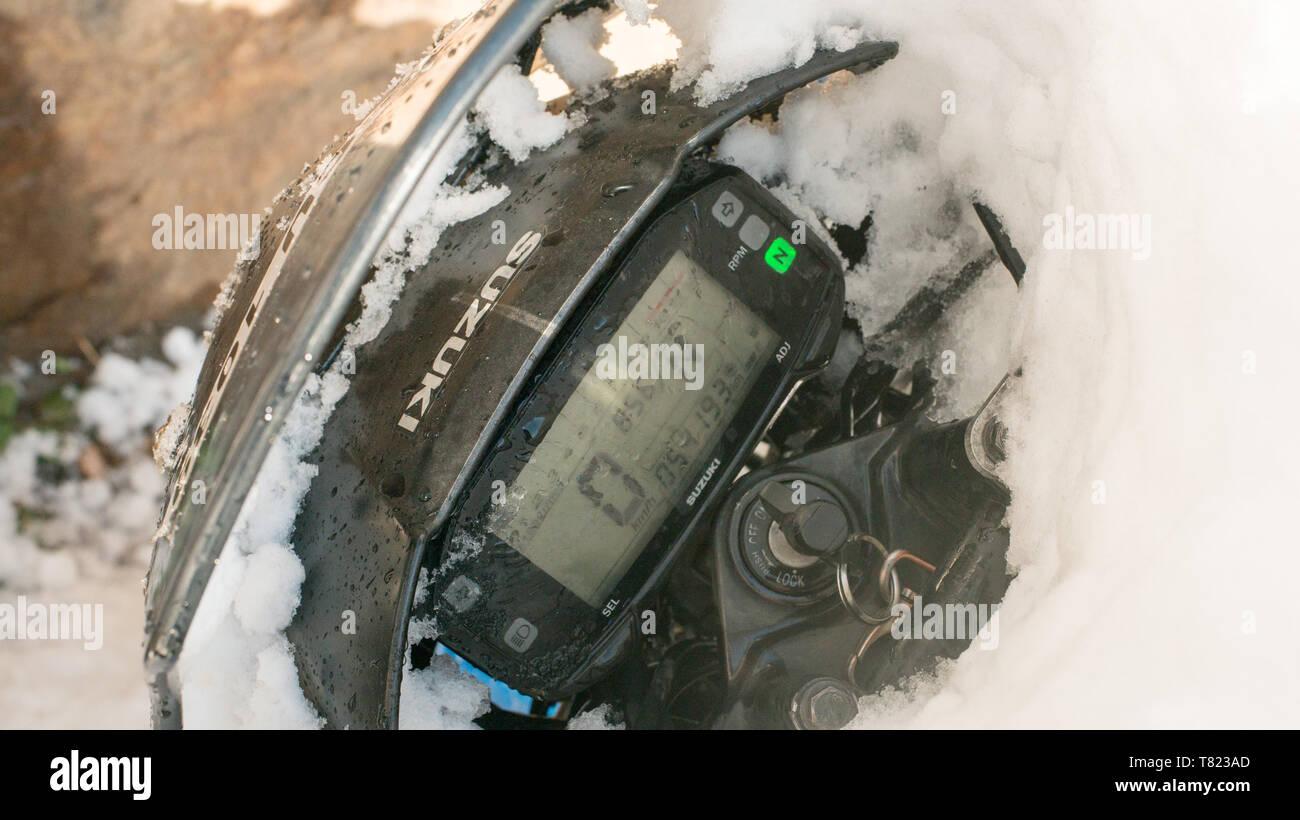 Kullu, Himachal Pradesh, India - Feburuary 08, 2019 : Snow covered Bike Speedometer in mountains - - Stock Image