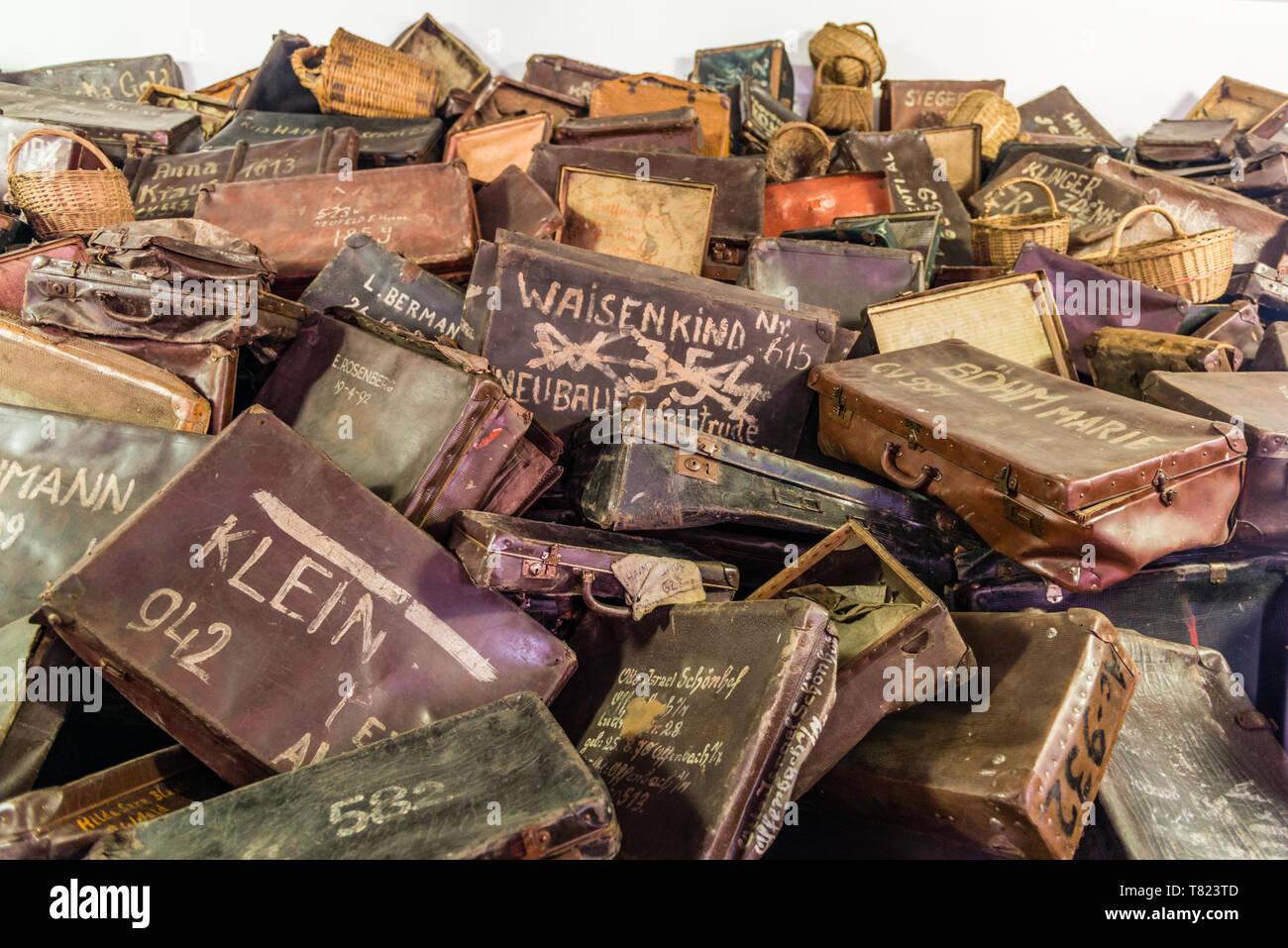 AUSCHWITZ (OSWIECIM), POLAND - APRIL 18, 2019: Suitcases of victims in Auschwitz I (main camp) in Oswiecim, Poland - Stock Image