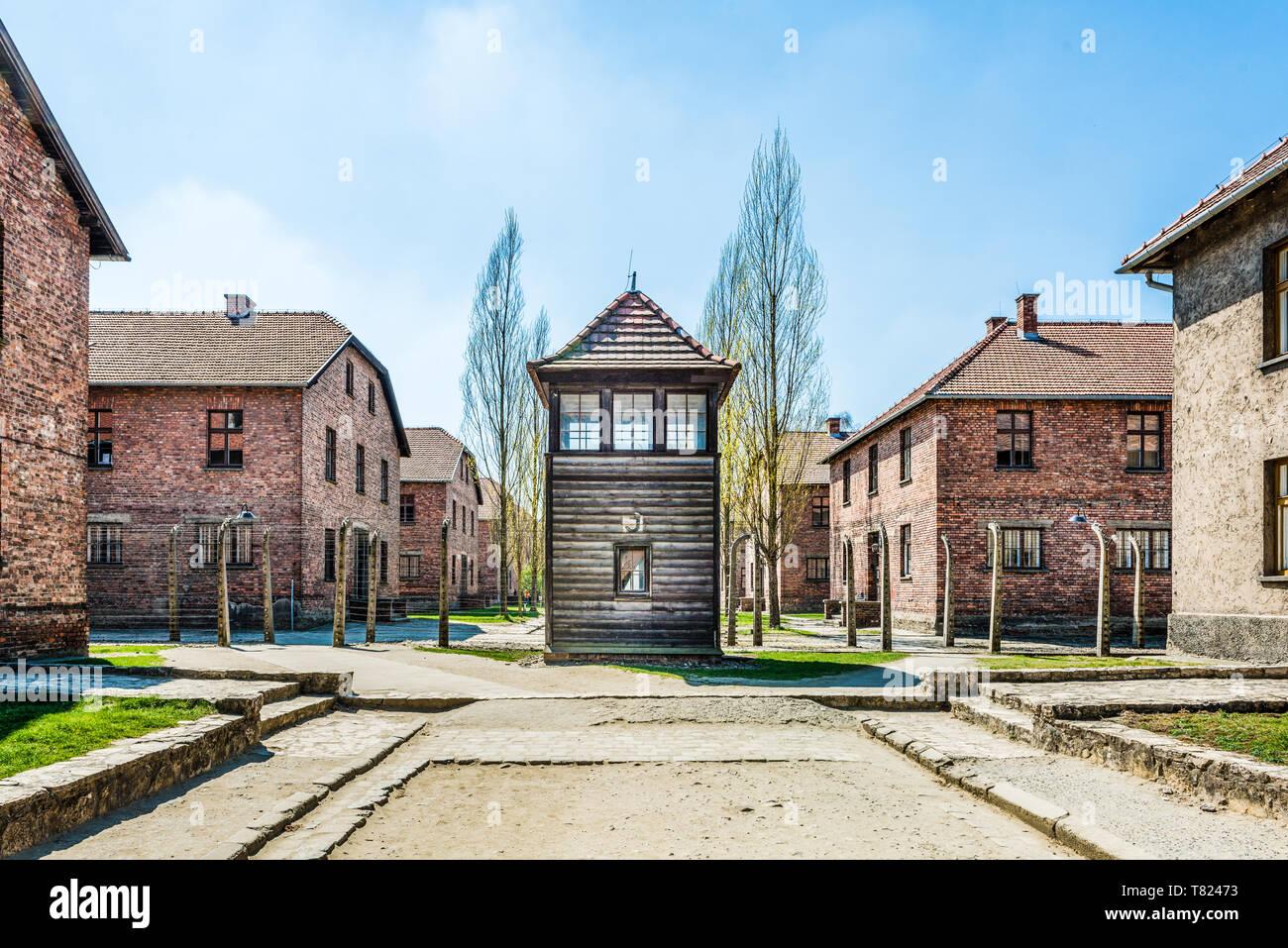 AUSCHWITZ (OSWIECIM), POLAND - APRIL 18, 2019: Guard tower and barracks Auschwitz I (main camp) in Oswiecim, Poland - Stock Image