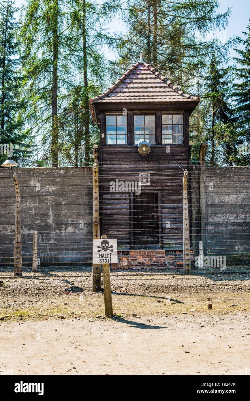 AUSCHWITZ (OSWIECIM), POLAND - APRIL 18, 2019: Guard tower and eletric fence Auschwitz I (main camp) in Oswiecim, Poland - Stock Image