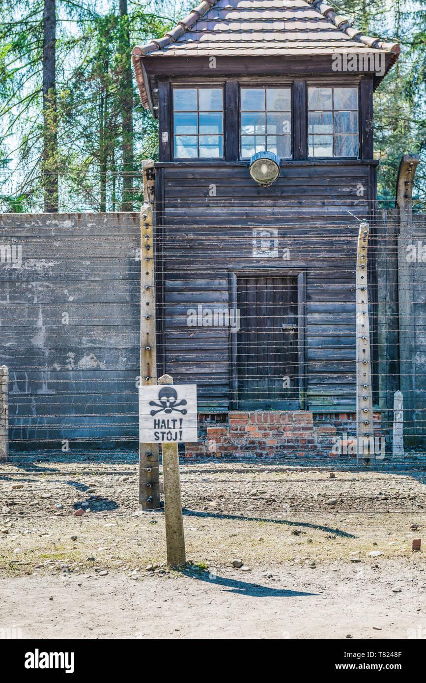 AUSCHWITZ (OSWIECIM), POLAND - APRIL 18, 2019: Guard tower and eletric fence in Auschwitz I (main camp) in Oswiecim, Poland - Stock Image