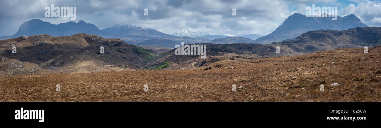 Looking over the hills of Assynt from Aird na Coigach with the peaks of Suilven, Canisp and Cul Mor closest to camera. A rain shower is approaching an - Stock Image