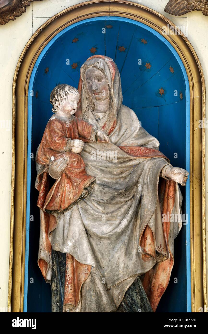 France, Jura, Saint Lothain, church dated 10th century, stone statue dated 11th century, Madonna and Child - Stock Image