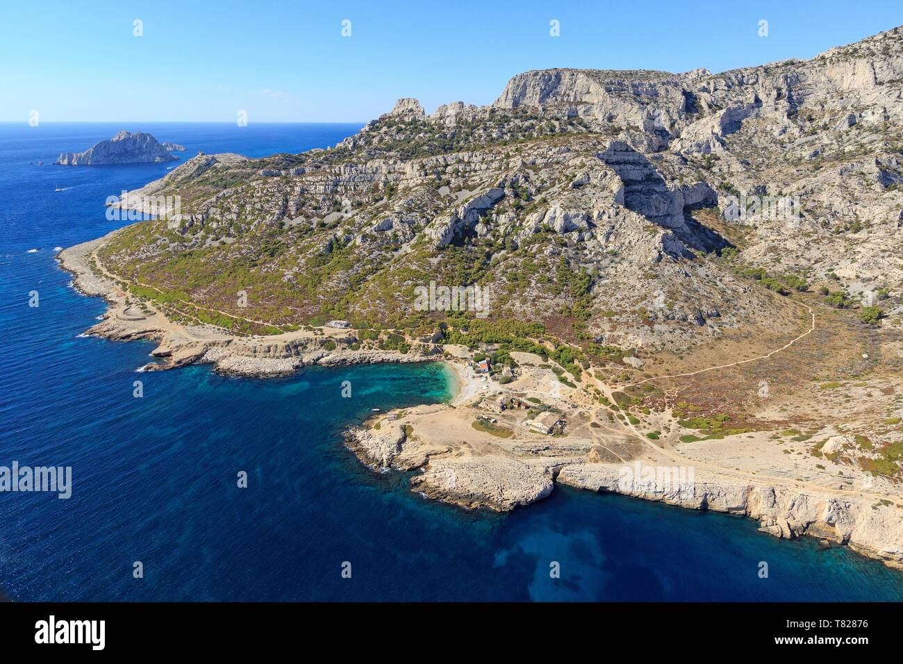 France, Bouches du Rhone, Calanques National Park, Marseille, 9th arrondissement, Marseilleveyre cove, Maire island in the background (aerial view) - Stock Image