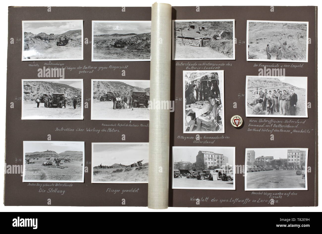 A photo album on the Spanish Civil War (1936 - 39) - Legion Condor With more than 280 excellent photographs of technical and geographical features. The album with captions, with information given by a regional manager of the truck section for Spain and Portugal of the company Henschel from Kassel. Several pictures of trucks in use, airplanes, Spanish cities (Burgos, Sevilla, Bilbao, Santander, Teruel, Lerida etc.). Also air raid shelters and positions, marching troops, destroyed buildings, fights at the Ebro, Teruel and Cubla fronts. With a pin for Henschel salesmen in Port, Editorial-Use-Only - Stock Image