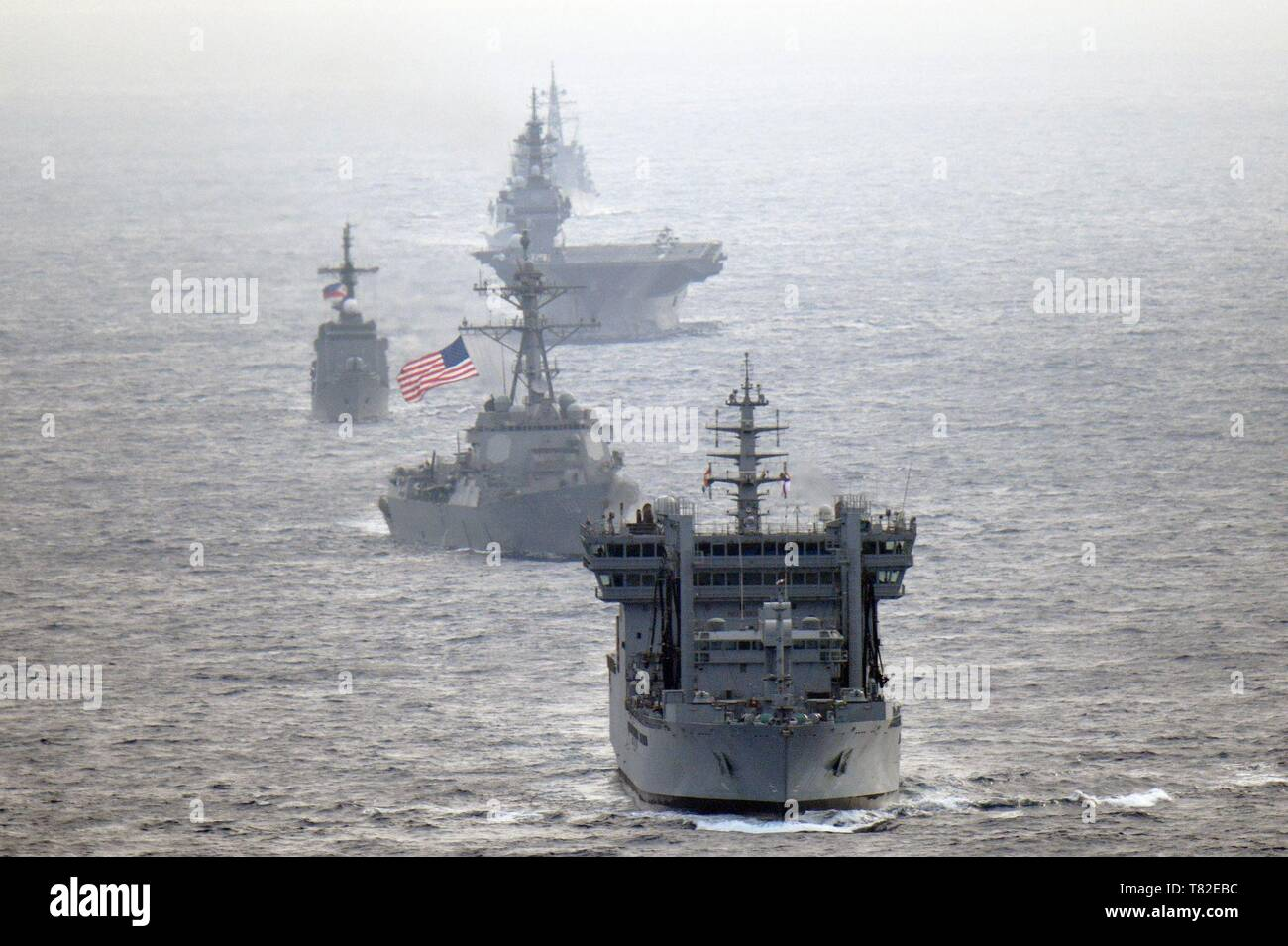 190505-N-XX012-0005 SOUTH CHINA SEA (May 5, 2019) The U.S. Navy guided-missile destroyer USS William P. Lawrence (DDG 110), center, transits international waters of the South China Sea with the Indian navy destroyer INS Kolkata (D 63) and tanker INS Shakti (A 57); the Japan Maritime Self-Defense Force helicopter carrier JS Izumo (DDH 183) and destroyer JS Murasame (DD 101); and the Republic of the Philippines navy patrol ship BRP Andres Bonifacio (PS 17). (U.S. Navy photo courtesy of the Japan Maritime Self-Defense Force/Released) - Stock Image