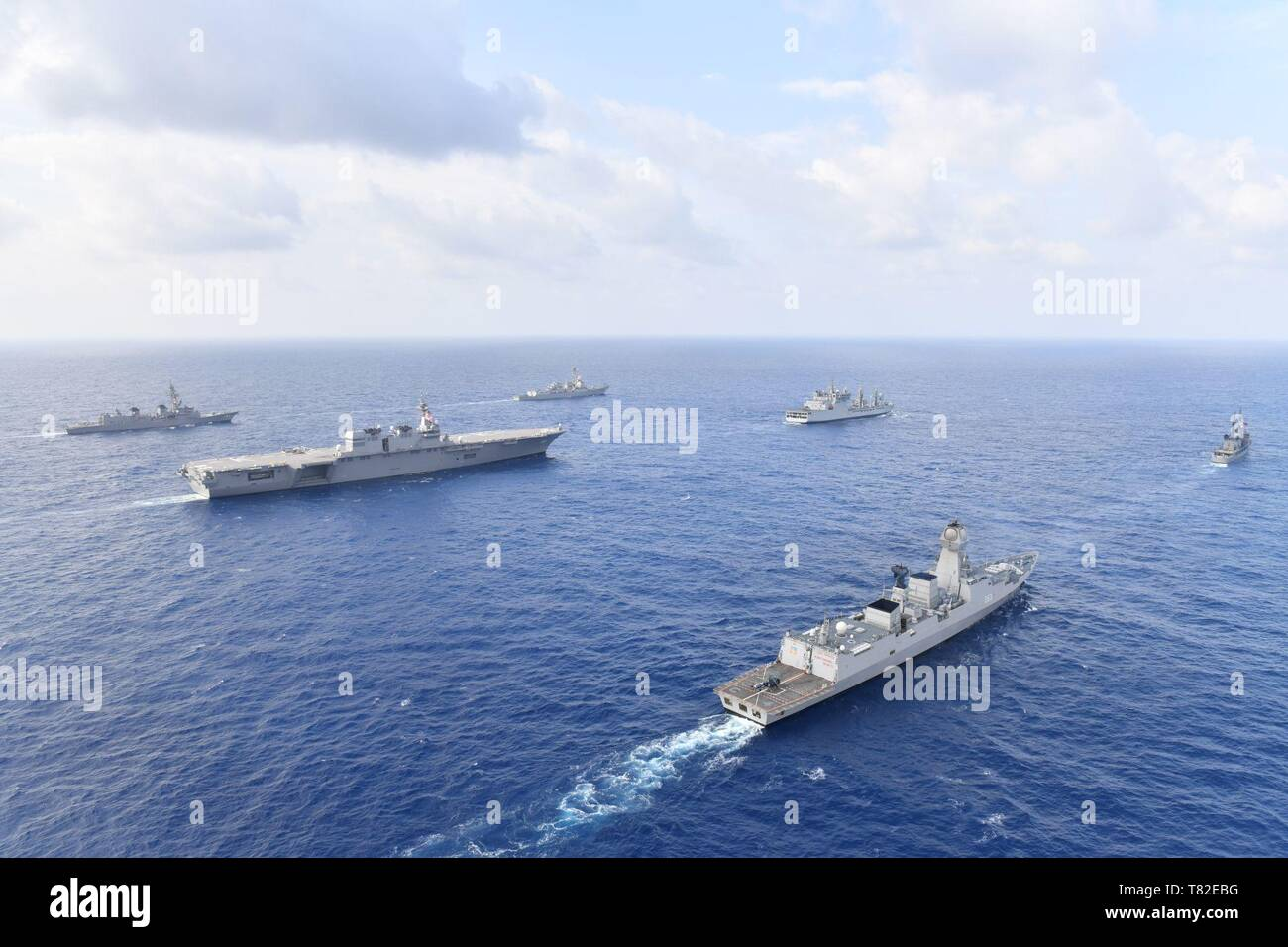 190505-N-XX012-0002 SOUTH CHINA SEA (May 5, 2019)  The U.S. Navy guided-missile destroyer USS William P. Lawrence (DDG 110), upper left, transits international waters of the South China Sea with the Indian navy destroyer INS Kolkata (D 63) and tanker INS Shakti (A 57); the Japan Maritime Self-Defense Force helicopter carrier JS Izumo (DDH 183) and destroyer JS Murasame (DD 101); and the Republic of the Philippines navy patrol ship BRP Andres Bonifacio (PS 17). (U.S. Navy photo courtesy of the Japan Maritime Self-Defense Force/Released) - Stock Image