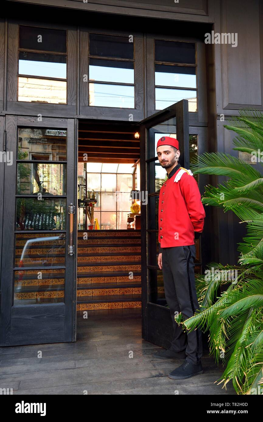 Georgia, Tbilisi, bellboy at the entrance of the Rooms hotel - Stock Image