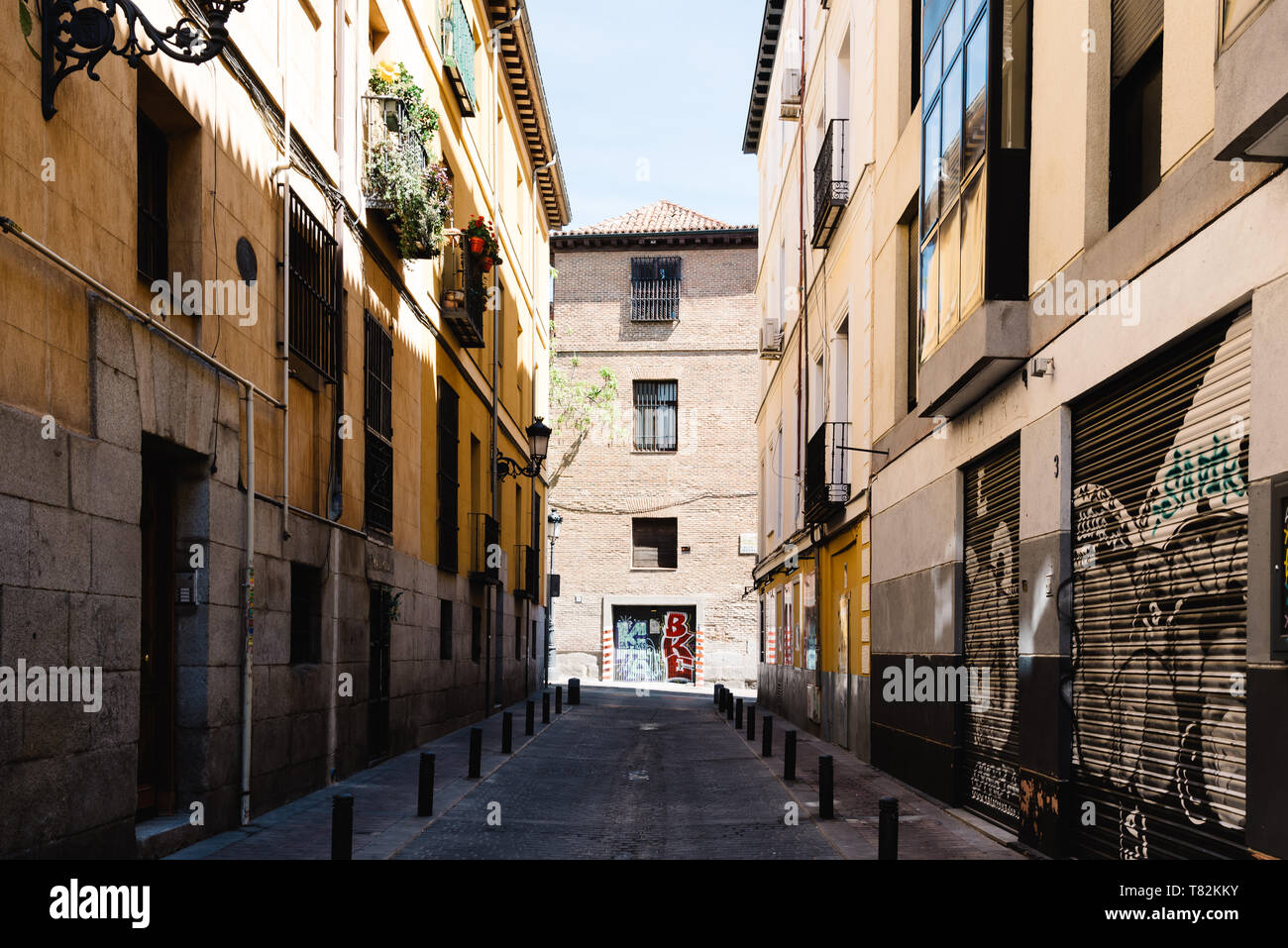 Madrid, Spain - May 2, 2019: Street in the picturesque Quarter of Las Letras. The neighbourhood is formed by narrow streets Stock Photo