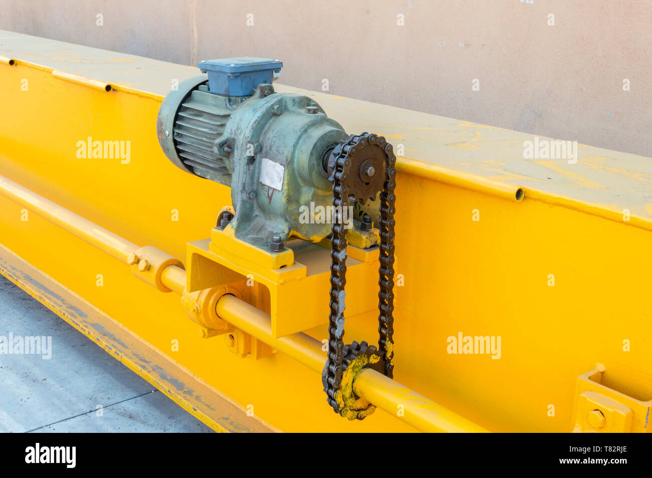 Parts of a crane ready for installation in the industrial plant. Overhead crane commonly called a bridge or gantry crane is a type of crane found in i Stock Photo
