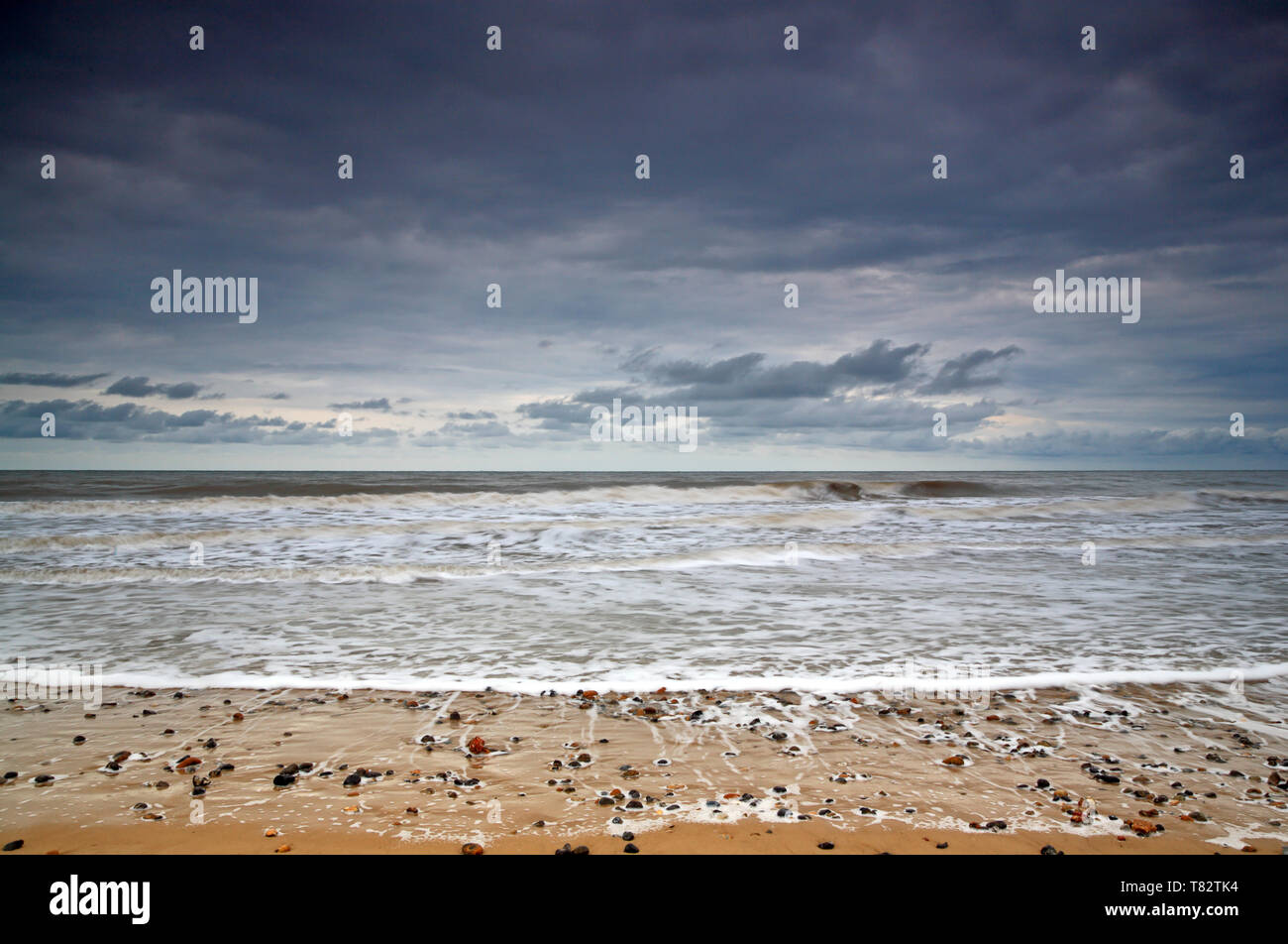 A view of a clearing showery sky over the sea from the beach at Happisburgh, Norfolk, England, United Kingdom, Europe. Stock Photo