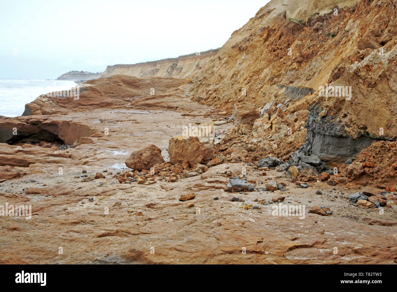 Eroding cliffs resulting from wave action and weathering on the Norfolk coast at Happisburgh, Norfolk, England, United Kingdom, Europe. - Stock Image