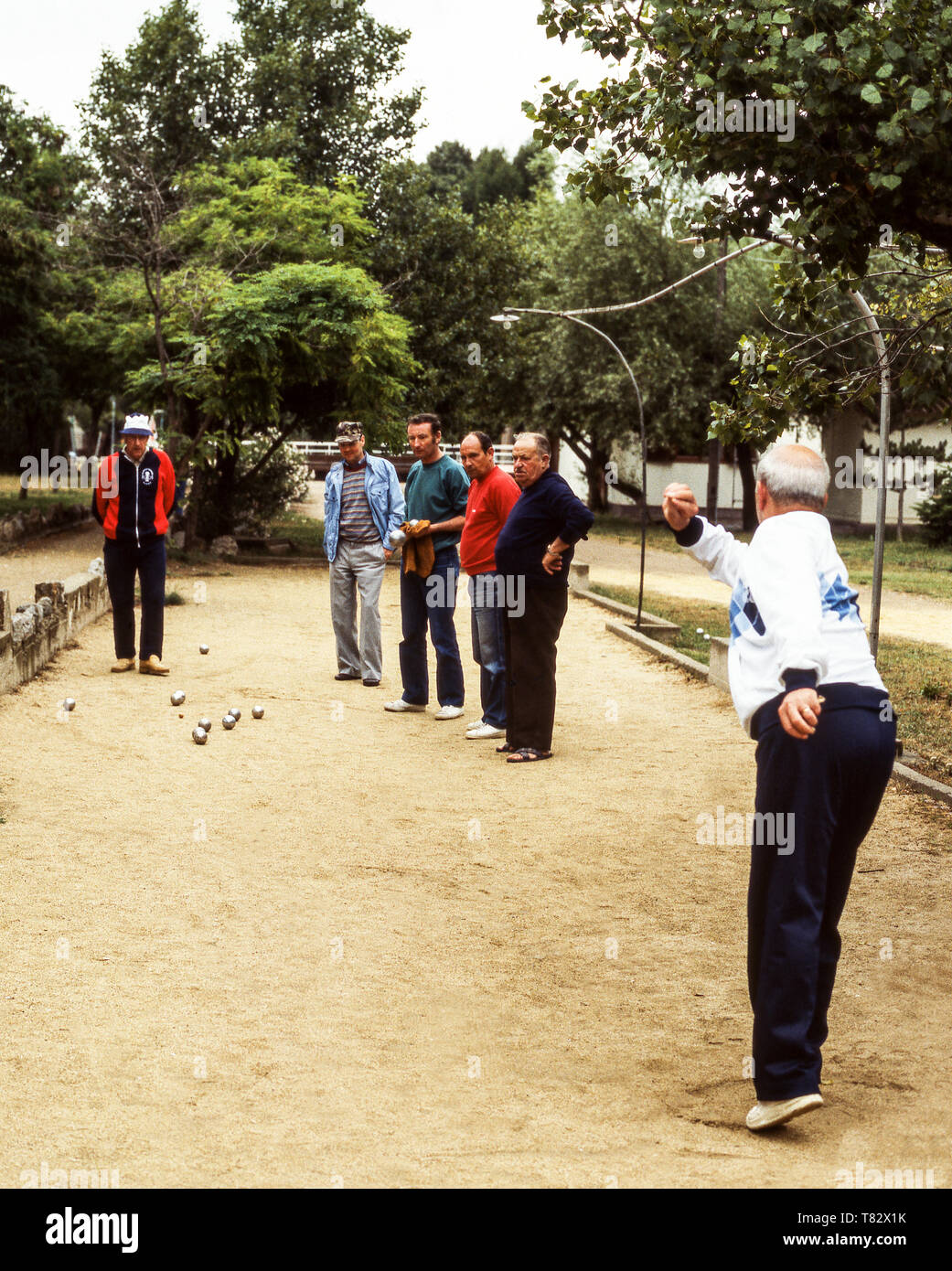 Men playing petanque or boule on a campsite in Mandelieu just outside Cannes on the French Riviera. - Stock Image