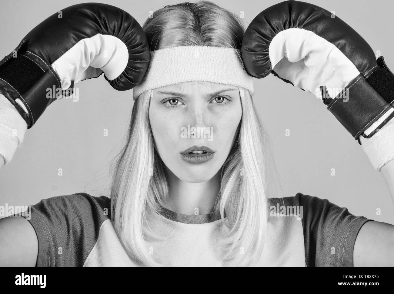 Girl boxing gloves tired to fight. Strong woman suffer pain. Girl painful face embrace head with boxing gloves. Headache remedies. Headache concept. Keep calm and get rid of headache. Beat headache. - Stock Image