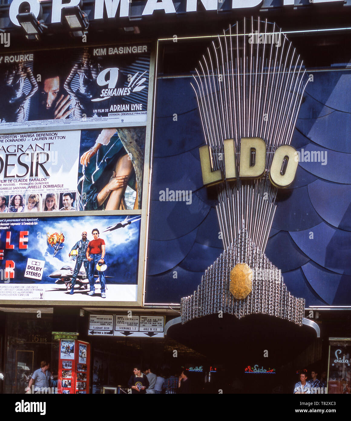 The Lido on the Champs-Elysees still offers a cabaret of girls with feathers. - Stock Image