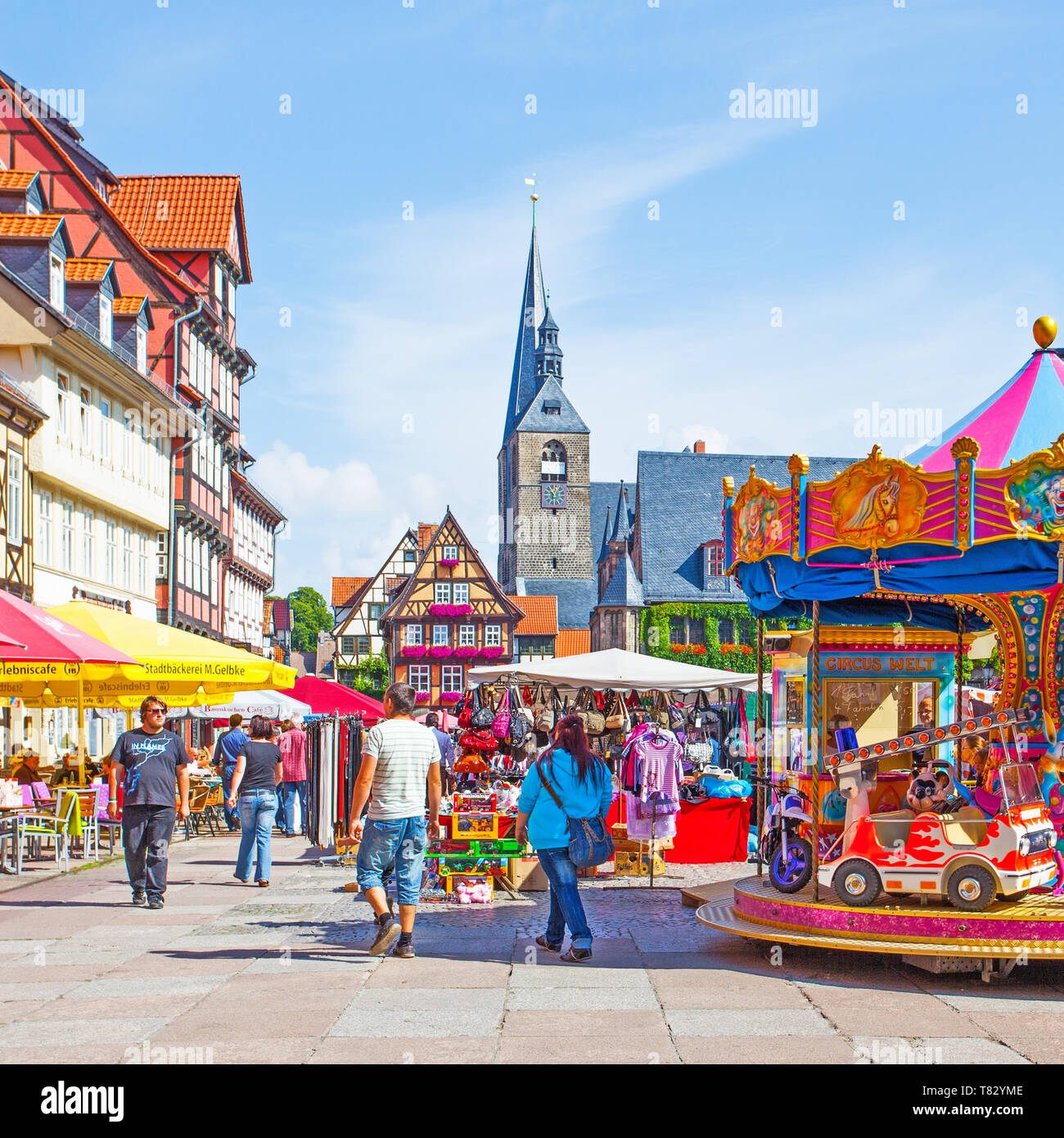 Quedlinburg, Germany - August 12, 2012: Fair in Markert Square and walking people in Quedlinburg Stock Photo