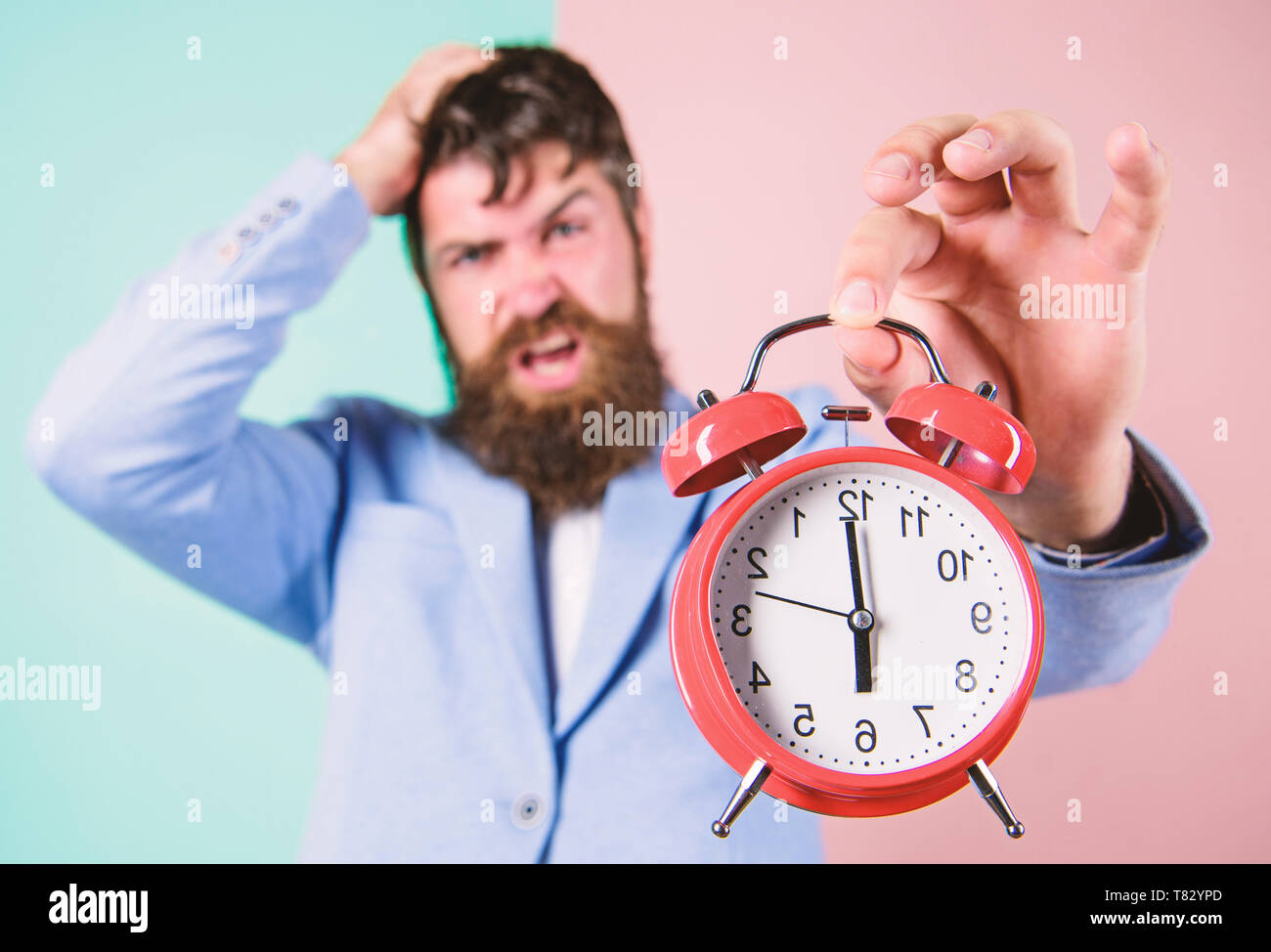 Time management skills. How much time left till deadline. Time to work. Man bearded stressful businessman hold clock. Stress concept. Hipster stressful working schedule. Businessman has lack of time. - Stock Image