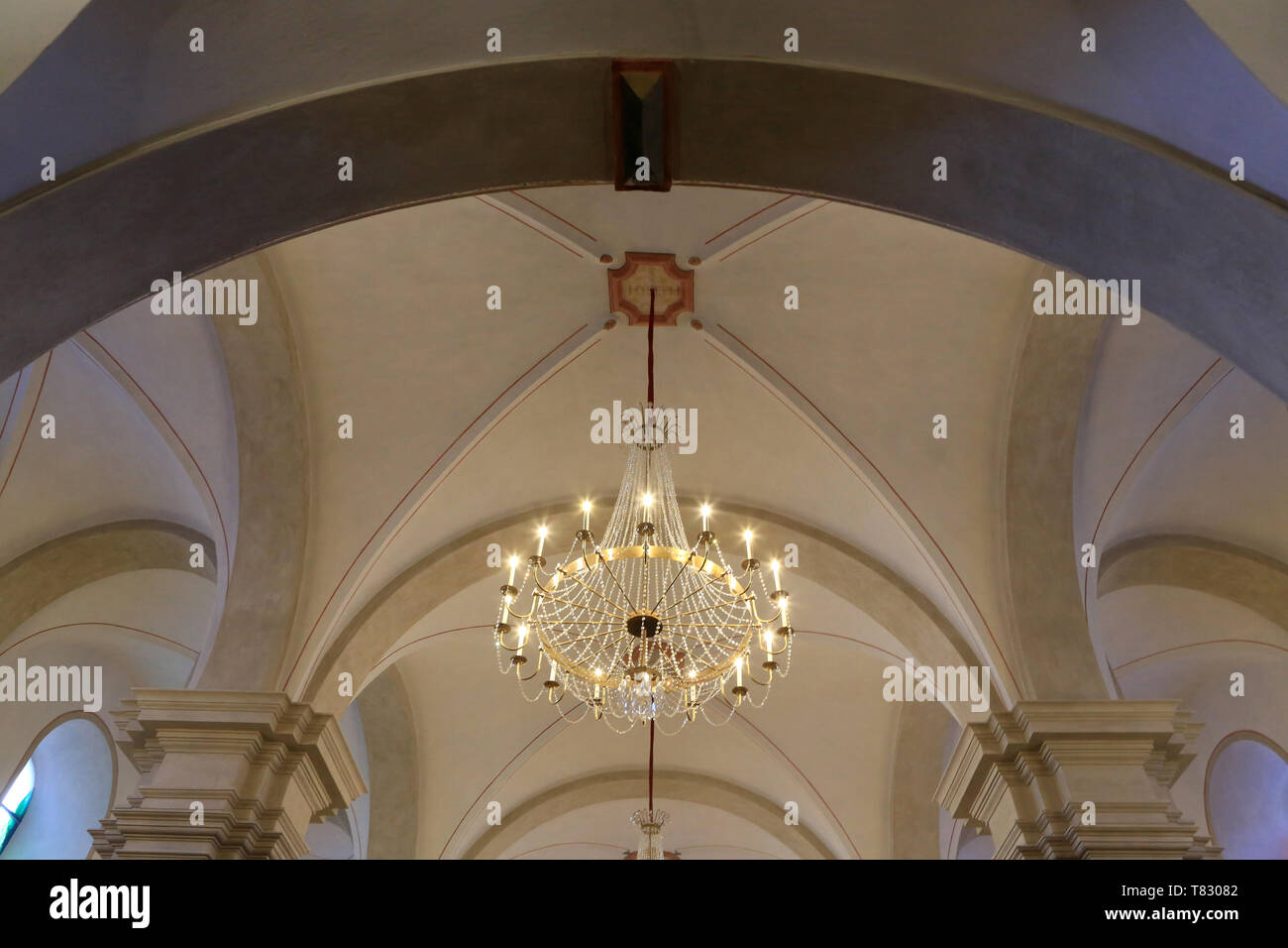 Lustre. Eglise Saint-Gervais et Saint-Protais. Saint-Gervais-les-Bains. / Church of St. Gervais and St. Protais. Saint-Gervais-les-Bains. - Stock Image
