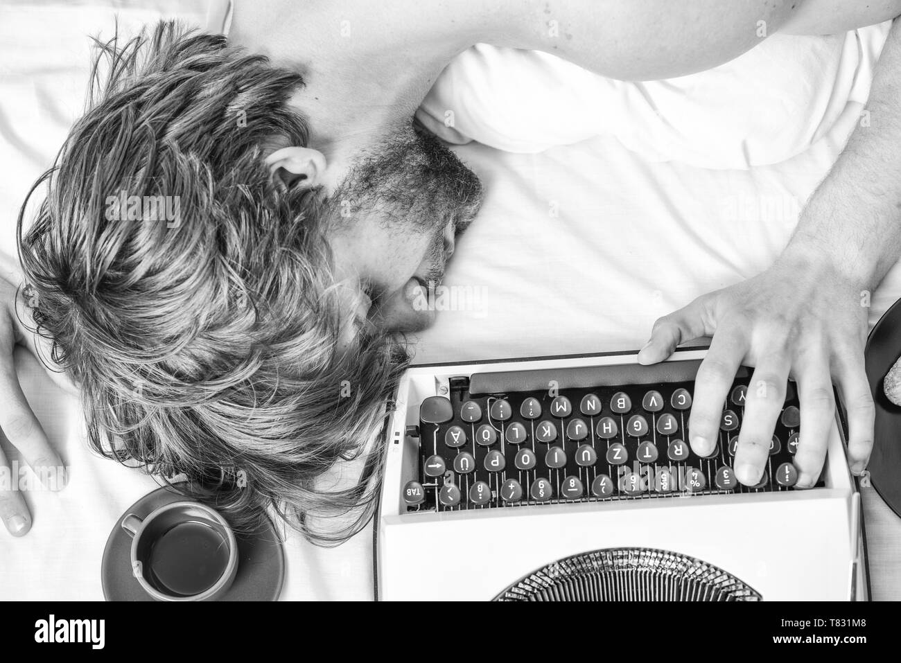 Author tousled hair fall asleep while write book. Workaholic fall asleep. Man with typewriter sleep. Deadline concept. Worked all night. Man fall asleep. Writer used old fashioned typewriter. - Stock Image