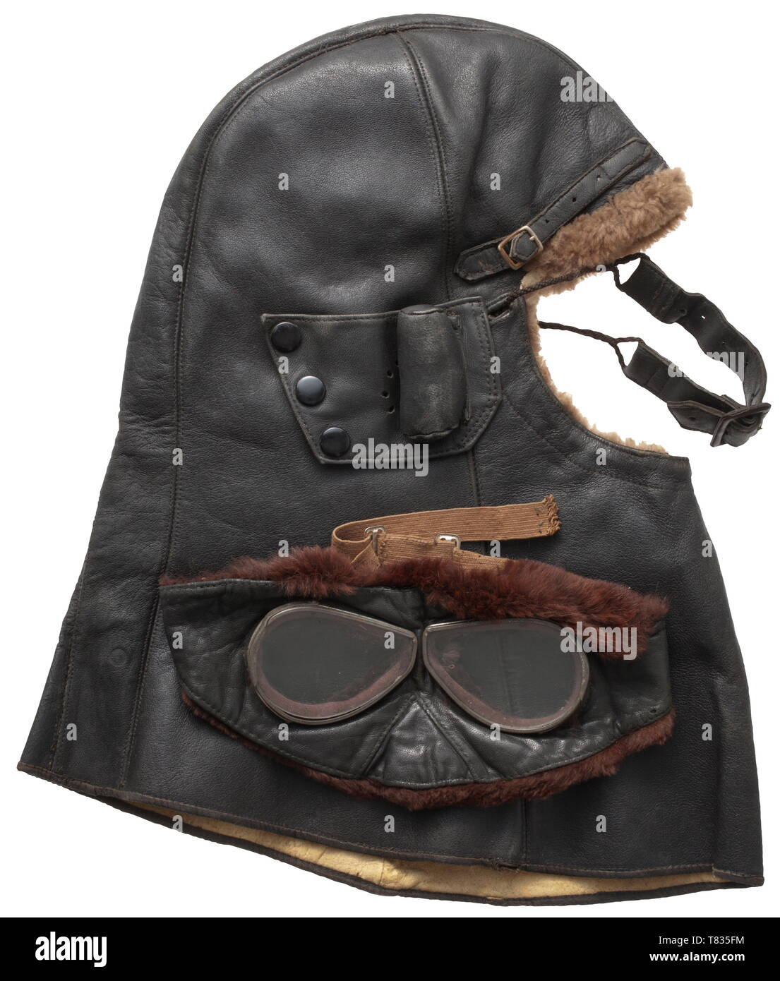 A flying cap with goggles of the Royal Naval Air Service Smooth black leather with elongated neck-guard typically worn by RNAS observers, rabbit fur lining. The sides with foldable ear cut-outs with press-buttons and ear protectors. Two adjustable leather drawstrings for the attachment of face protection and goggles. Including face mask with a switch frame for goggle lenses. Fine dark grey leather with rabbit fur lining, light brown drawstring (slightly brittle), all without maker's marks. Rare equipment set of the RNAS. historic, historical, troop, troops, armed forces, mi, Editorial-Use-Only Stock Photo