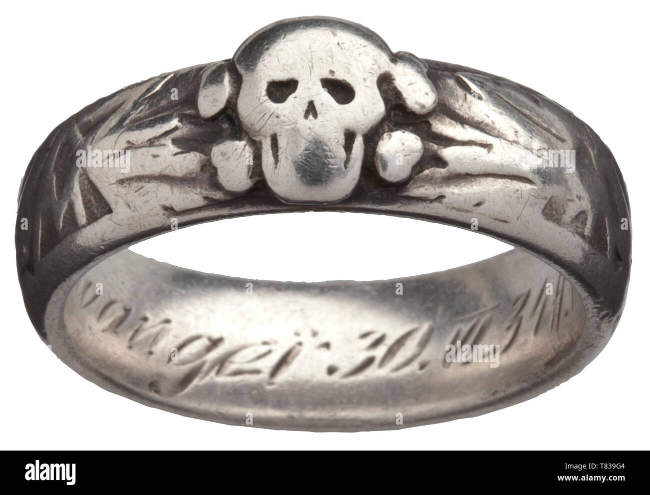 """An SS honour ring custom-made by the jeweller Gahr in Munich, soldered underneath the separately applied death's head, the inside surface with engraved dedication """"S.lb. Ellwanger 30.VI.34 H. Himmler"""". Weight 9.7 grammes, inside diameter 20 mm, heavily used. The ring comes from family possession and has never been in collectors´ hands before. historic, historical, 20th century, 1930s, 1940s, Waffen-SS, armed division of the SS, armed service, armed services, NS, National Socialism, Nazism, Third Reich, German Reich, Germany, military, militaria, utensil, piece of equipment, Editorial-Use-Only Stock Photo"""