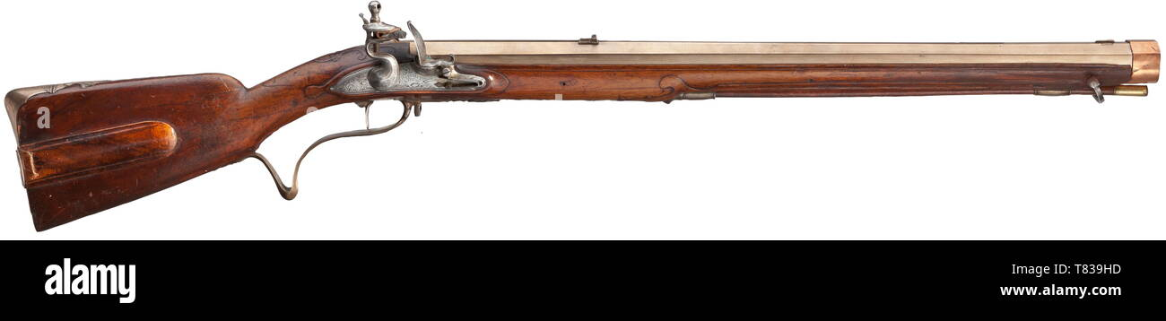 "A flintlock rifle with bronze barrel Johann Joseph Futter, Dresden, circa 1770. Heavy, seven-groove rifled octagonal barrel made from bronze in 14 mm calibre, with dovetailed bronze sights. Iron flintlock with engraved rocailles, with signature ""FUTTER A DRESDE"" and (defective) single set trigger. Florally carved walnut full stock with copper muzzle ring. The bronze furniture engraved and in relief, the trigger guard engraved ""F.B. No: 28"". Wooden ramrod with brass tip. The closure spring of the patch-box is missing. Length 108 cm. Johann Joseph , Additional-Rights-Clearance-Info-Not-Available Stock Photo"