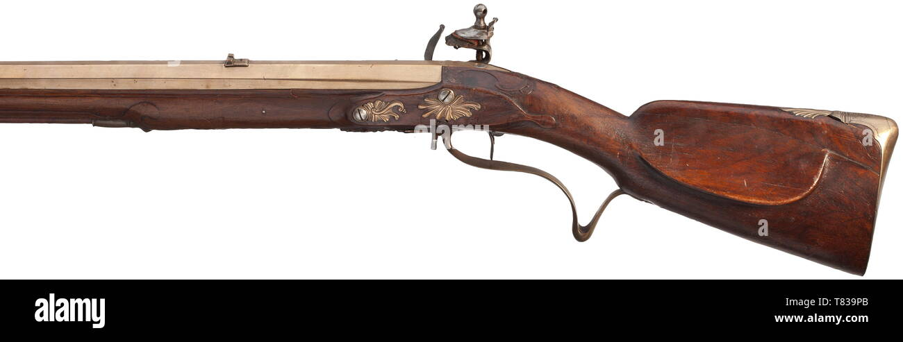 """A flintlock rifle with bronze barrel Johann Joseph Futter, Dresden, circa 1770. Heavy, seven-groove rifled octagonal barrel made from bronze in 14 mm calibre, with dovetailed bronze sights. Iron flintlock with engraved rocailles, with signature """"FUTTER A DRESDE"""" and (defective) single set trigger. Florally carved walnut full stock with copper muzzle ring. The bronze furniture engraved and in relief, the trigger guard engraved """"F.B. No: 28"""". Wooden ramrod with brass tip. The closure spring of the patch-box is missing. Length 108 cm. Johann Joseph , Additional-Rights-Clearance-Info-Not-Available Stock Photo"""