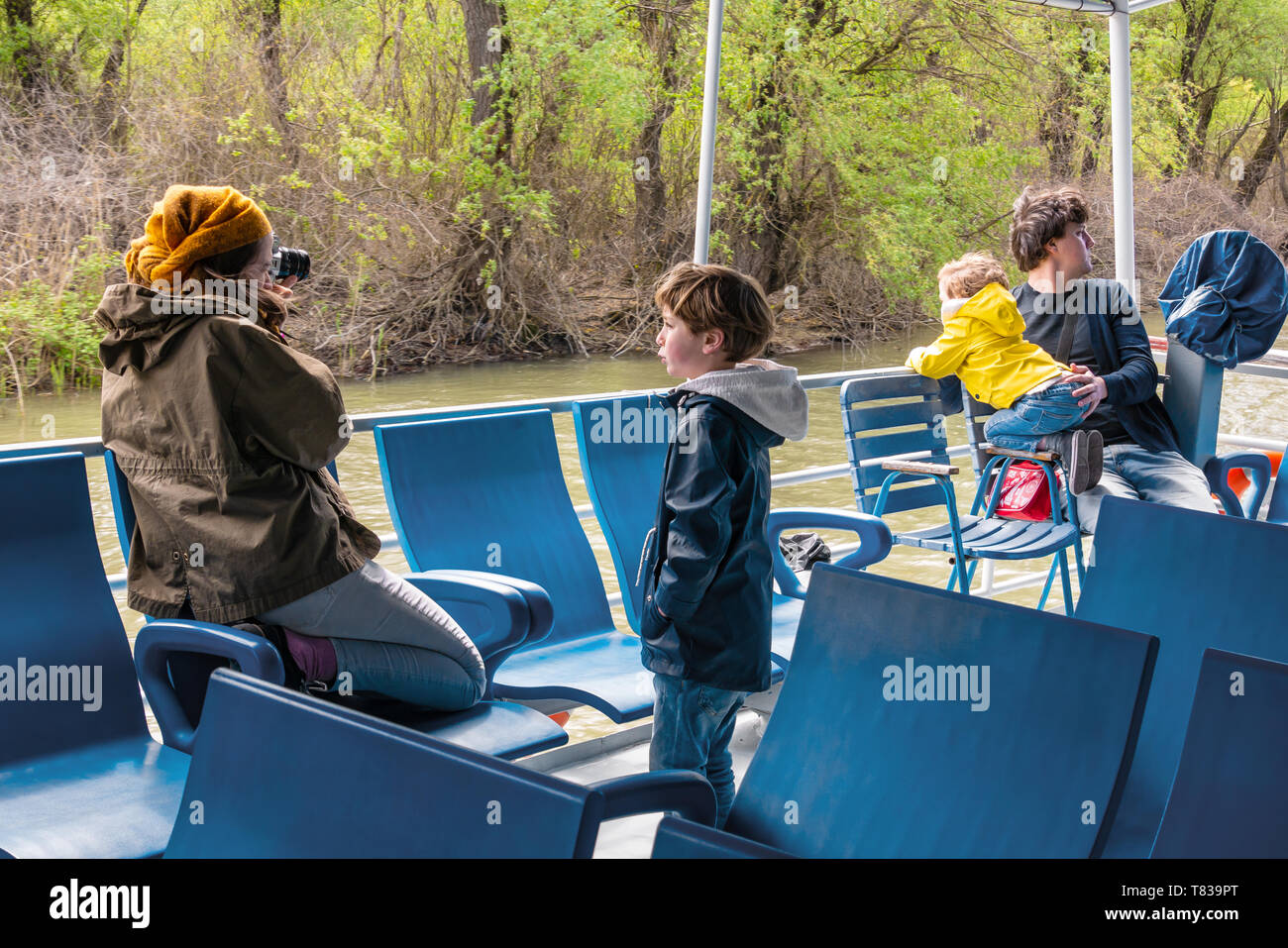 Nature Reserve Delta of the Danube River. Romania. April 20, 2019. A cruise ship swims along the river. Tourists on the deck of a cruise ship view and Stock Photo