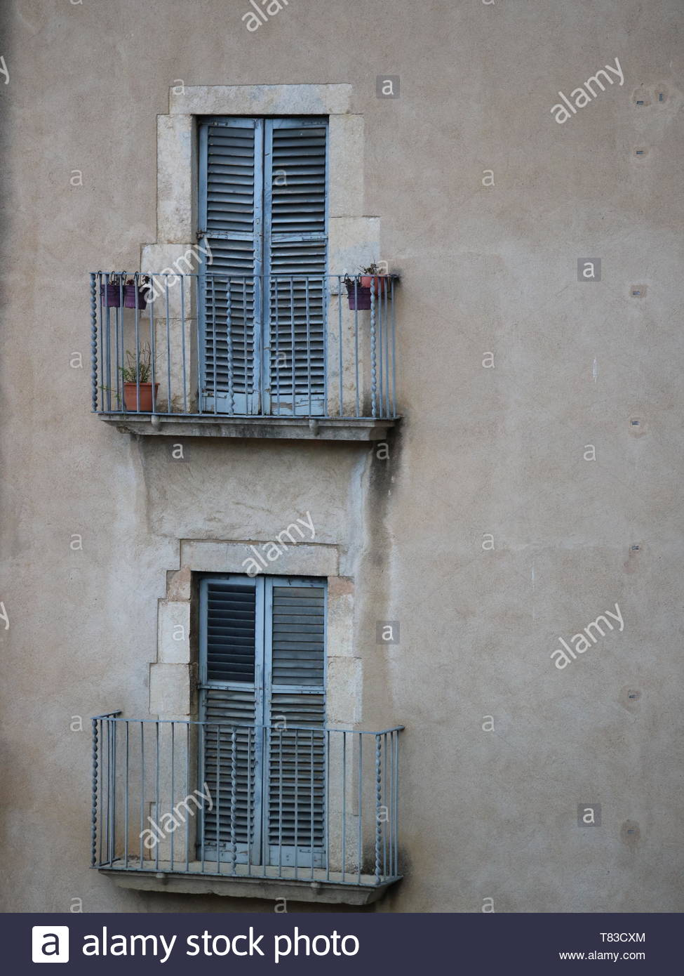 Old Shuttered windows with balconies viewed from the Cathedral de Girona Spain - Stock Image