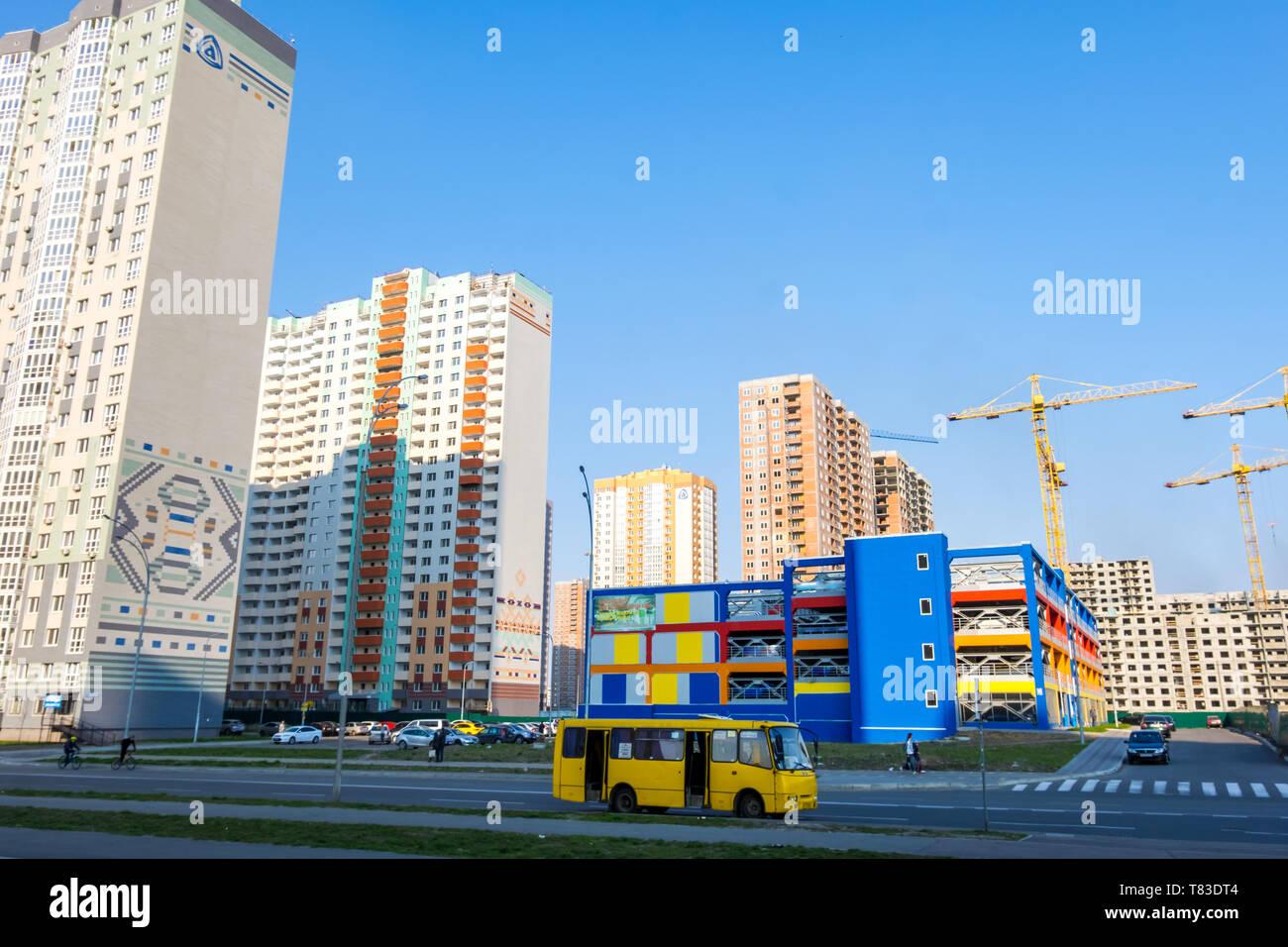 Kyiv, Ukraine - April 06, 2019: New buildings and bright colorful parking on Poznyaki residential area in Darnitskiy district of Kyiv, Ukraine - Stock Image