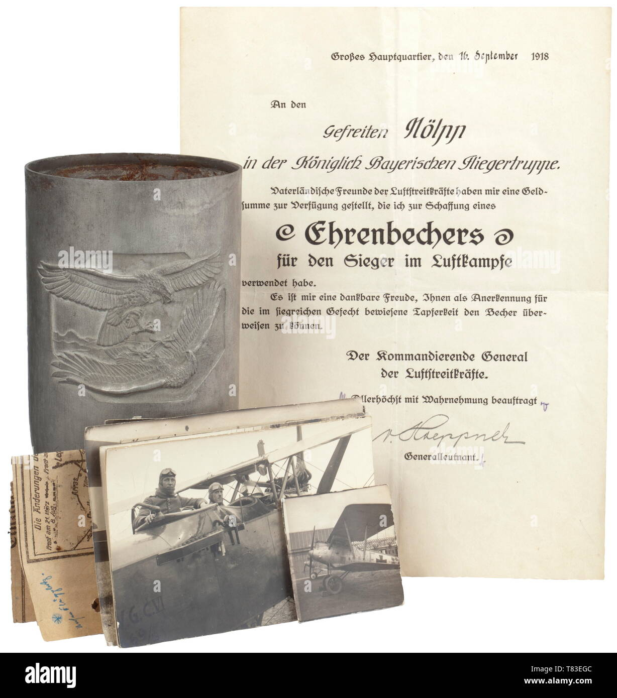 """The estate of Karl Nölpp From the Bavarian flying corps, goblet of honour for victors in the air war including certificate. Iron, silver plating only minimally existent. The obverse with a fighting eagle and the banner """"To the victor in the air war"""" in relief. In the base remains of the stamp """"Head of the Field Flying Corps"""". Height circa 20 cm, weight 332 g. Certificate for the goblet of honour for a victor in the air war, issued on 16 September 1918 in the Central Headquarters with original signature of Lieutenant General von Hoeppner and two other signatures, watermark """", Editorial-Use-Only Stock Photo"""
