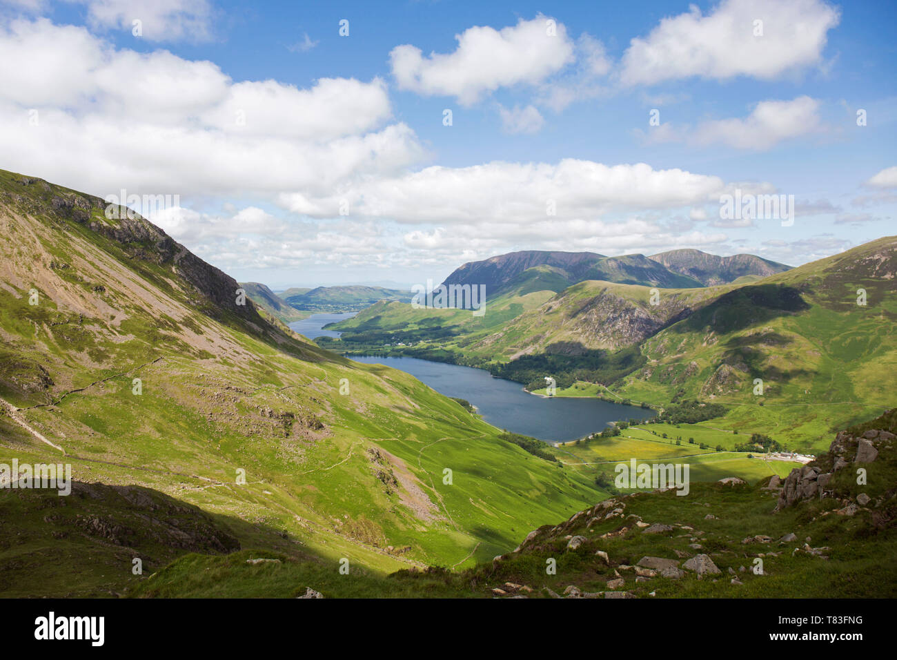 Lake District National Park, Cumbria, England. View over Buttermere and distant Crummock Water from the western slopes of Haystacks. - Stock Image