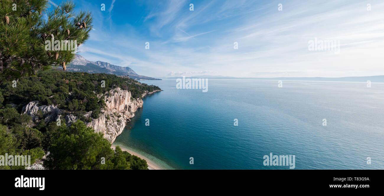 Panorama landscape over hidden beach on sunny summer day in Croatia - Stock Image