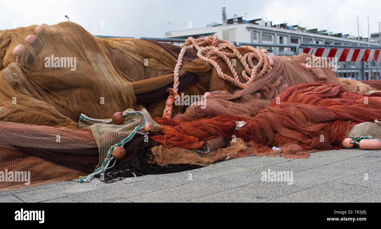 Fischernetze am Hafen - Stock Image